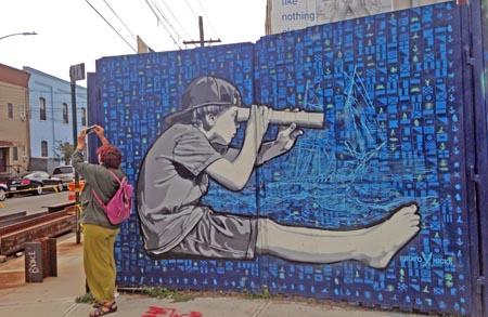 Mural of boy holding spyglass