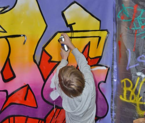 boy painting on wall