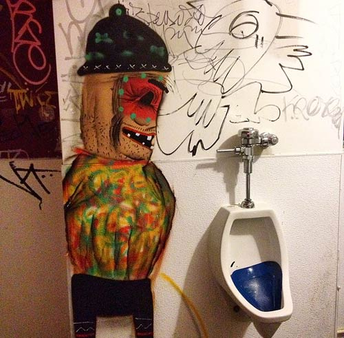 cartoon character urinating in bathroom