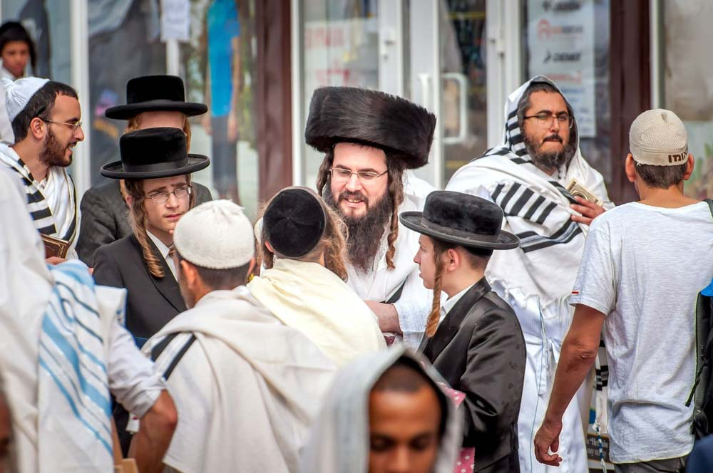 Hassidic men standing together