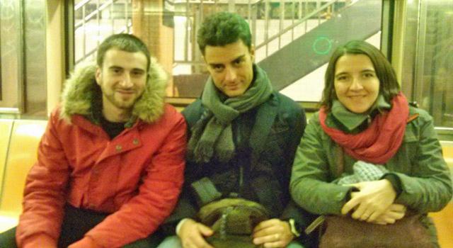 tour group posing on subway