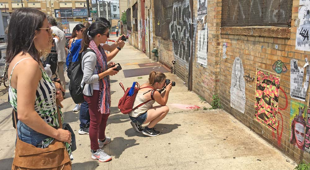 tourists photographing street art