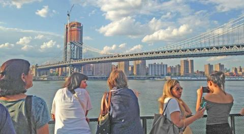 People looking at skyline of view and Manhattan Bridge.